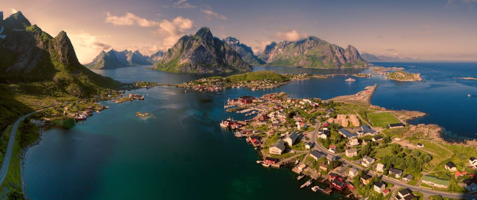 Breathtaking aerial panorama of fishing town Reine and surrounding fjords on Lofoten islands in Norway, famous for its picturesque scenery, Tomas Griger